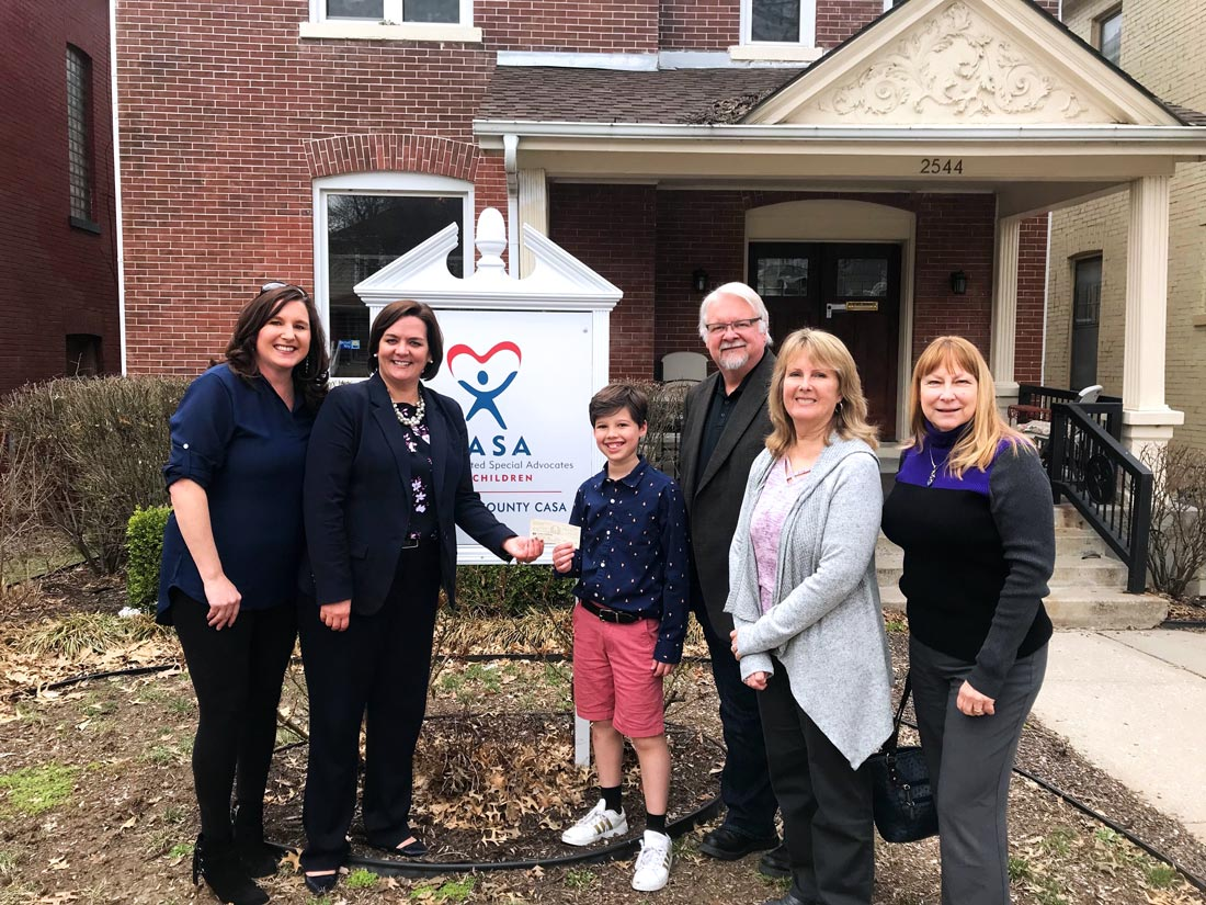 Members of Leawood Stage Company community theater near Kansas City donating to CASA