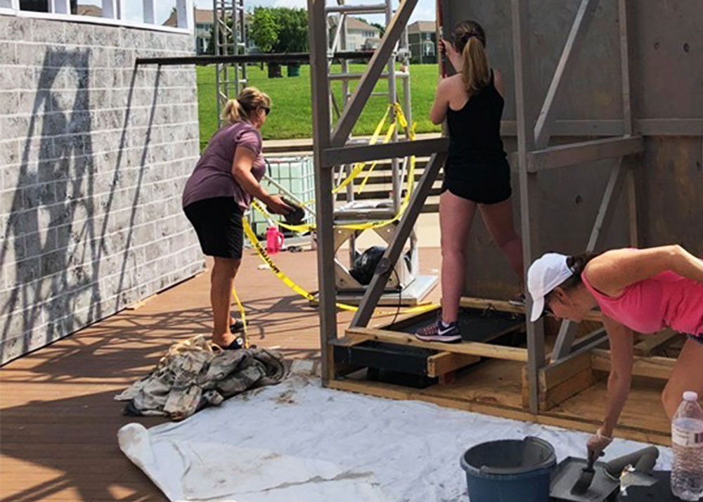Volunteers working on the summer musical production of Kiss Me Kate at Leawood-Stage-Company Community Theatre