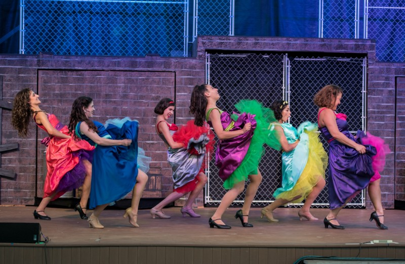 Community Theatre actors dancing in Leawood Stage Company's free summer production of the musical West Side Story