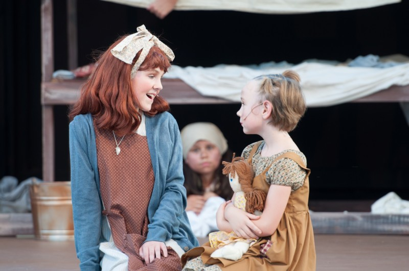 Community Theatre actors dancing in Leawood Stage Company's free summer production of Annie