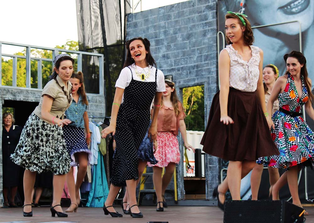 A group of community theatre actors dancing in the musical Kiss Me Kate at Leawood Stage Company near Kansas City