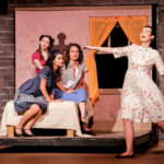 Community theatre actors singing in Leawood Stage Company's production of West Side Story