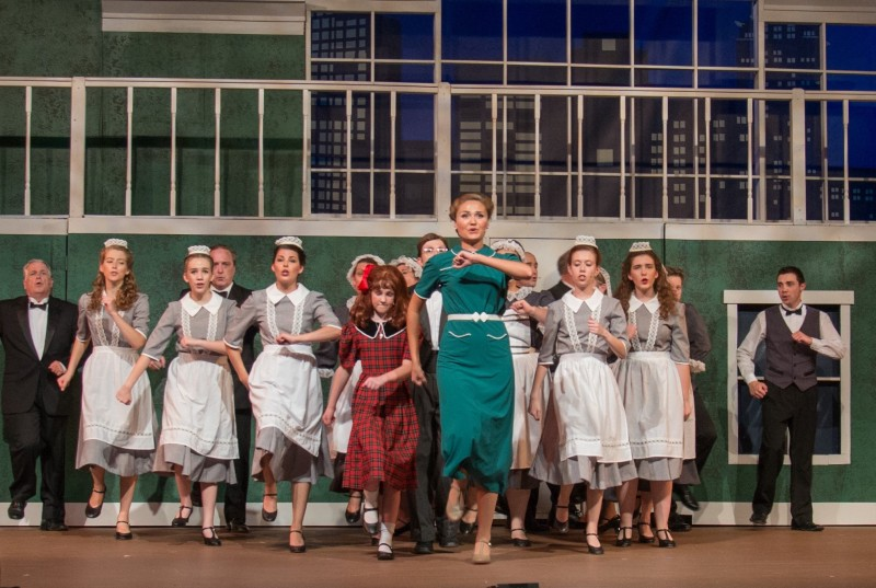 A group of community theatre actors dancing in Leawood Stage Company's production of the musical Annie