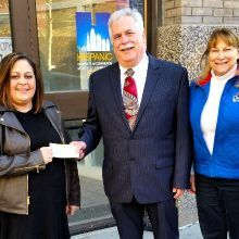 Vice Chair, Rod Chapin and April Bishop (Cultural Arts Coordinator for the City of Leawood, KS) present a check to the Puerto Rican Society of Greater Kansas City representing proceeds from West Side Story - July 2018 in honor of Leawood Stage Company's 20th Anniversary, A Season of Shows with Purpose.